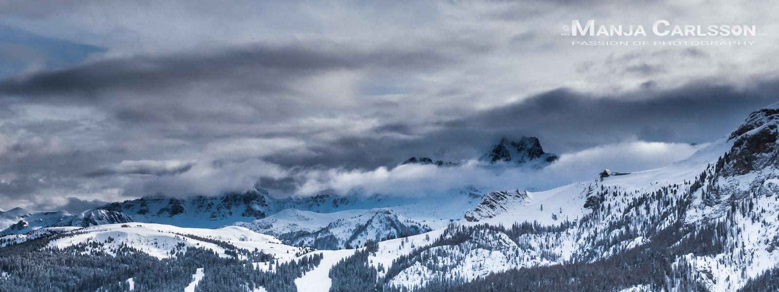 Dolomiten, Alta Badia und Marmolada unter Schneewolken am Nachmittag © Manja Carlsson